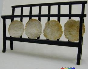 Manfi Cakes drying on a traditional Manfi rack